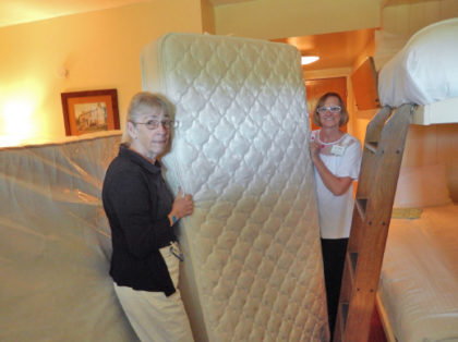 Employees moving a mattress